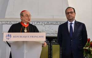 French President Francois Hollande, right, stands listening as Cuba's Cardinal Jaime Ortega speaks at a ceremony in the French Embassy where Ortega was honored with the Order Commander of the Legion of Honor  in Havana, Cuba, Monday, May 11, 2015. (Adalberto Roque/Pool Photo via AP)