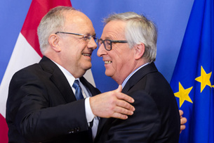 European Commission President Jean-Claude Juncker, right, welcomes the President of Swiss Confederation Johann Schneider Ammann upon his arrival at the EU Commission headquarters in Brussels on Friday, Jan. 15, 2016. (AP Photo/Geert Vanden Wijngaert)